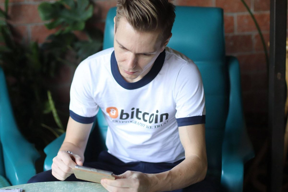 Enjoying time In Cryptography We Trust Bitcoin T-shirt at coffee shop